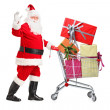 Santa Claus pushing cart full of presents — Stock Photo #45880885
