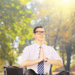 Young businessperson doing yoga — Stock Photo