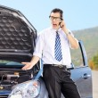 Nervous man next to his broken car — Stock Photo