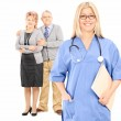 Mature couple posing behind doctor — Stock Photo #45882205