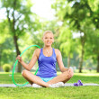 Female fitness instructor in park — Stock Photo