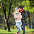Couple kissing in park — Stock Photo #45882715