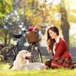 Beautiful female with dog — Stock Photo #45883131