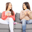 Two teenage girls playing cards — Stock Photo