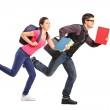 Students rushing forwards with books — Stock Photo #45884077