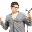 Confused male holding electronic cables — Stock Photo #45884107