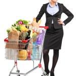 Woman next to shopping cart — Stock Photo #45884453