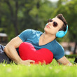 Male lying on grass with red heart — Stock Photo #45885059