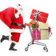 Santa Claus pushing shopping cart — Stock Photo #45886545