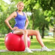 Female athlete sitting on a ball — 图库照片 #45886691