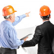 Construction workers with orange helmets — Stock Photo #45888269