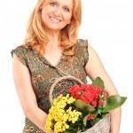 Woman holding basket flowers — Stock Photo