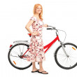 Mature woman with bicycle — Stock Photo