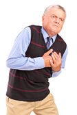 Mature man having heart attack — Stock Photo