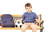 Schoolboy with school bag and football — Foto de Stock