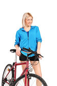 Female posing next to bicycle — Stock Photo
