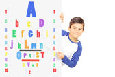 Boy pointing on eyesight test — Stock Photo