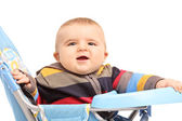 Boy sitting in baby stroller — Stock Photo