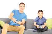 Brothers on a sofa playing video game — Stock Photo