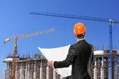 Foreman holding blueprints — Stock Photo