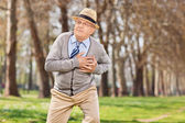 Senior having a cardiac arrest — Stock Photo