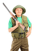 Ale hunter holding rifle — Stock Photo