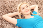 Blond smiling female lying — Stock Photo