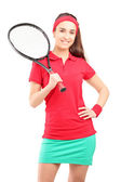 Female holding tennis racket — Stock Photo