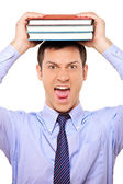 Student holding book over head — Stockfoto