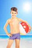 Smiling kid holding beach ball — Stock Photo