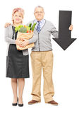 Couple holding paper bag — Stock Photo