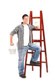 Male standing next to ladder — Stock Photo