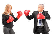 Businesswoman with boxing gloves fight — Stock Photo