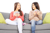 Two teenage girls playing cards — Стоковое фото