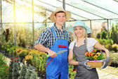 Male and female gardeners with basket — Stock Photo