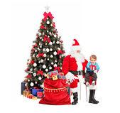 Santa Claus giving gift to child — Foto de Stock