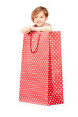 Child in red shopping bag — Stock Photo