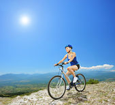 Female biker on bike — Stockfoto