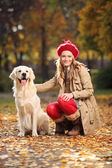 Woman posing with dog — Stock Photo