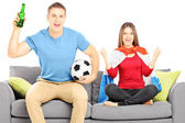 Female and male sport supporters cheering — Stock Photo