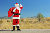Santa claus on an open road — Stock Photo