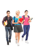 Three students walking — Stock Photo