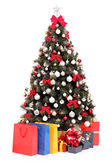 Christmas tree with gifts and bags — Stock fotografie