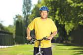 Man on his bike in park — Stock Photo