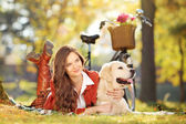 Female with dog in park — Stock Photo