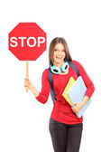Woman holding a traffic sign stop — Stock Photo