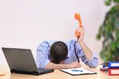 Exhausted businessman with face down — Stock Photo