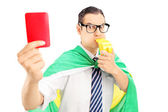 Fan with flag holding red card — Foto Stock