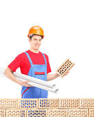 Male engineer holding brick — Stockfoto