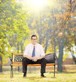 Relaxed businessman in park — Stock Photo
